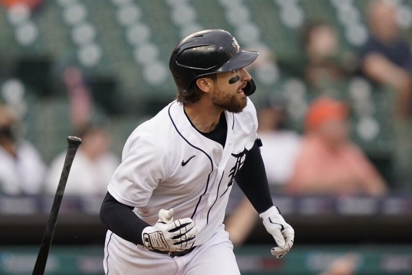 Detroit Tigers' Eric Haase watches his two-run home run during the first inning of a baseball game against the Seattle Mariners, Tuesday, June 8, 2021, in Detroit. (AP Photo/Carlos Osorio)