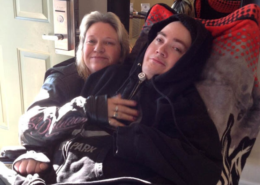Brandon Maxfield with his mother, Sue Stansberry, in 2013.