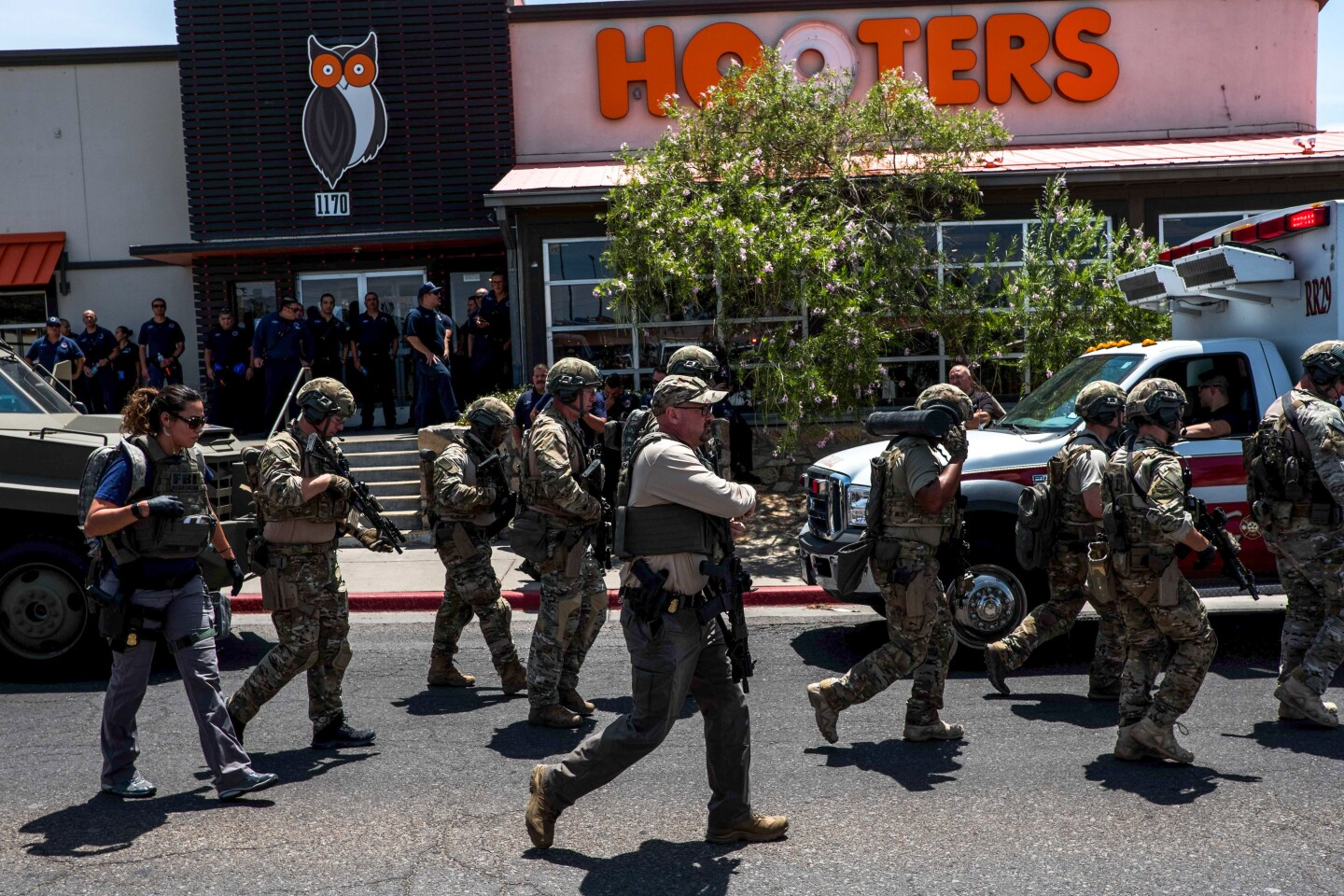 """Law enforcement agencies respond to an active shooter at a Wal-Mart near Cielo Vista Mall in El Paso, Texas, Saturday, Aug. 3, 2019. - Police said there may be more than one suspect involved in an active shooter situation Saturday in El Paso, Texas. City police said on Twitter they had received """"multi reports of multipe shooters."""" There was no immediate word on casualties. (Photo by Joel Angel JUAREZ / AFP) (Photo credit should read JOEL ANGEL JUAREZ/AFP/Getty Images) *** BESTPIX *** ** OUTS - ELSENT, FPG, CM - OUTS * NM, PH, VA if sourced by CT, LA or MoD **"""