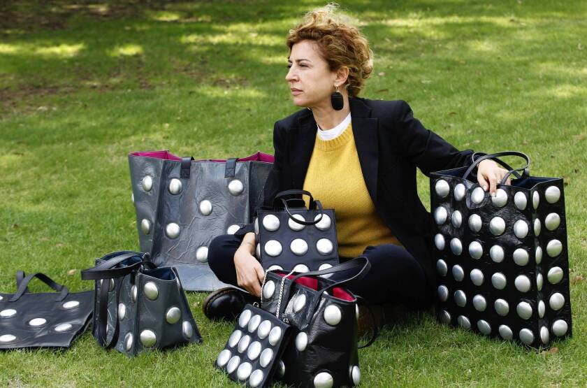 Ilaria Venturini Fendi with bags from her Carmina Campus fashion project that produces bags from repurposed materials in Dallas.