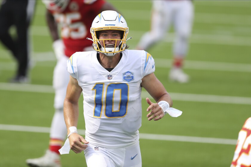 Los Angeles Chargers quarterback Justin Herbert celebrates after his first career NFL touchdown pass.