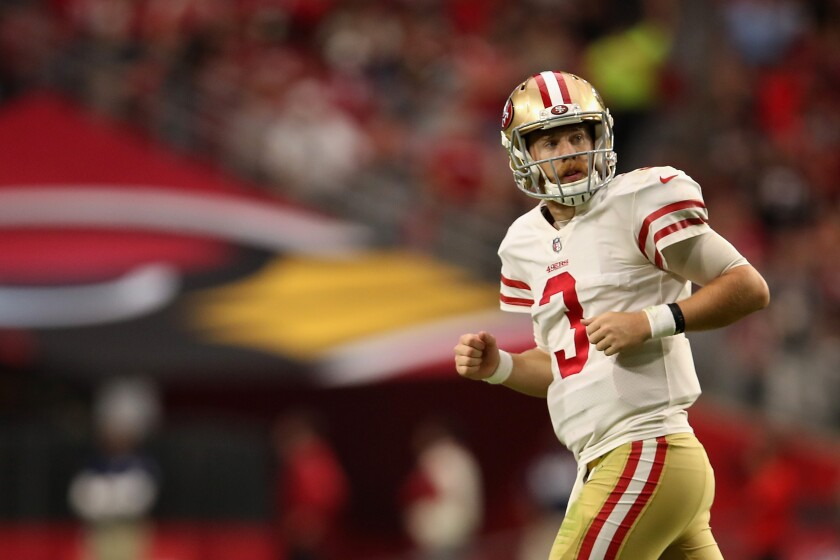 San Francisco quarterback C.J. Beathard runs off the field during a game against the Cardinals on Oct. 28 at State Farm Stadium.