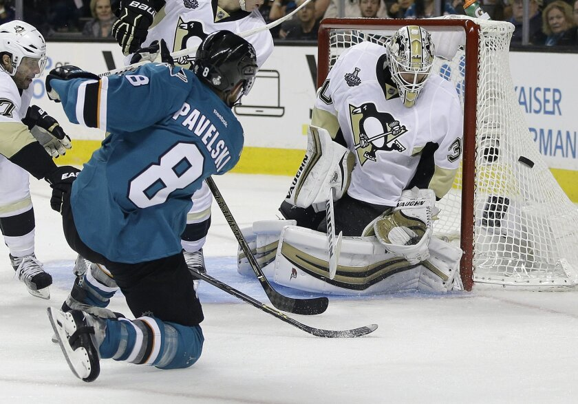 San Jose Sharks center Joe Pavelski (8) misses a shot against Pittsburgh Penguins goalie Matt Murray during overtime of Game 3 of the NHL hockey Stanley Cup Finals in San Jose, Calif., Saturday, June 4, 2016. (AP Photo/Marcio Jose Sanchez)