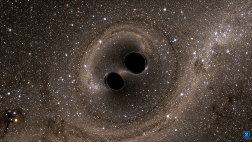 The collision of two black holes is depicted in a computer simulation.