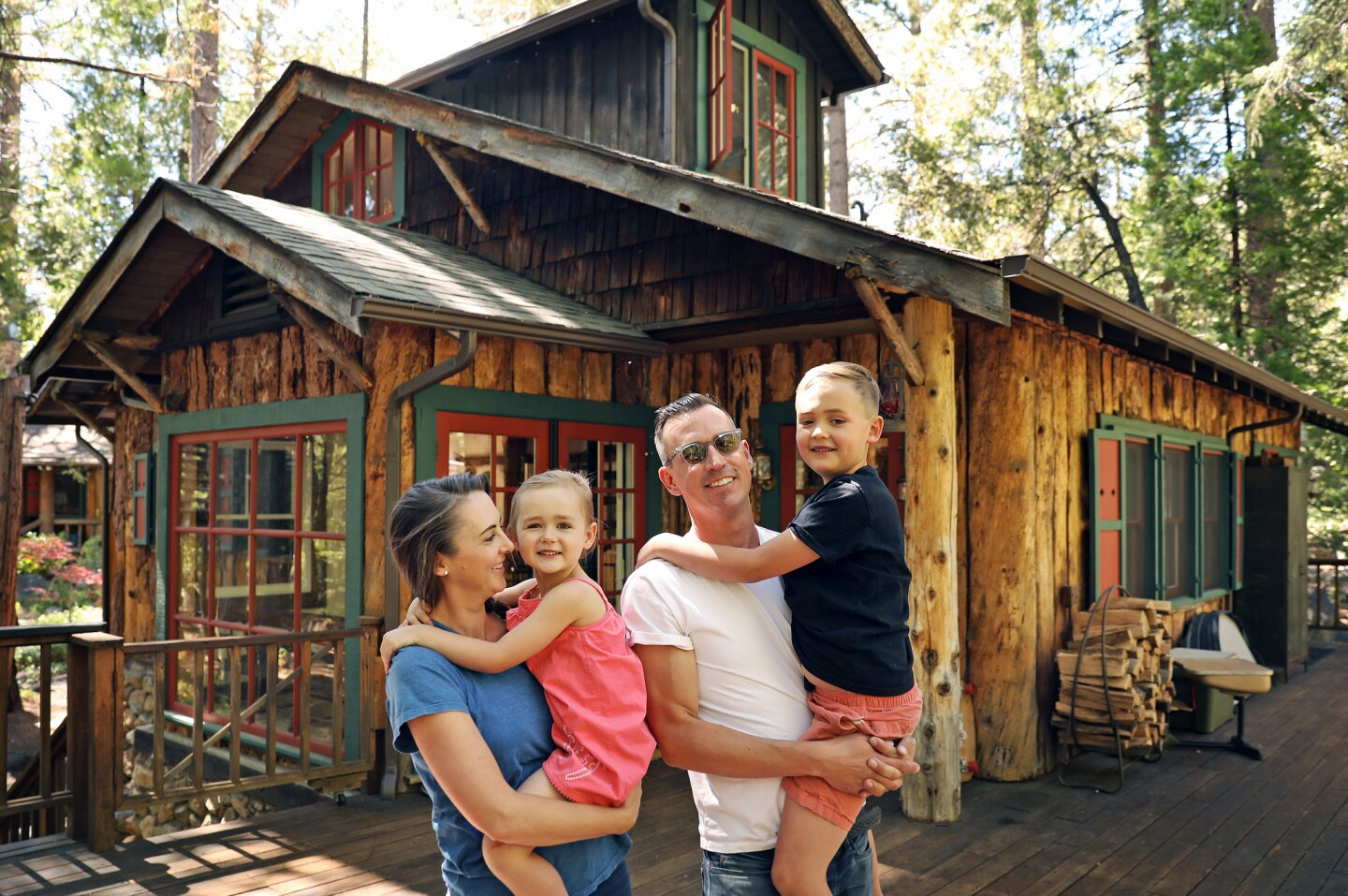The Donovan family left Silver Lake for Idyllwild after visiting a for-sale home on a lark. The property's two structures date to the early 1920s. Catherine with Bon, age 4, and Michael with Tate, 7.