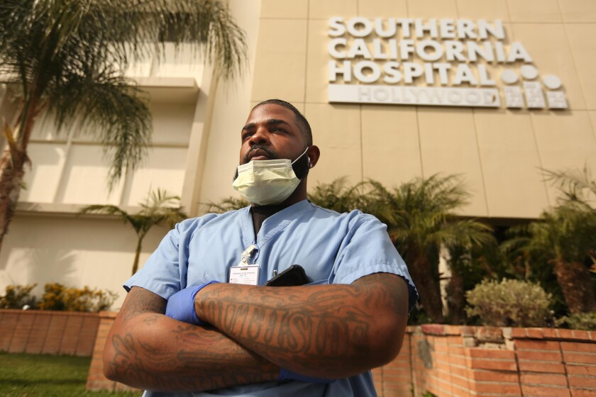 Andre Ross, 30, is a floor care specialist at Southern California Hospital in Hollywood. He disinfects the floors of patients' rooms, including possibly those of COVID-19 patients.