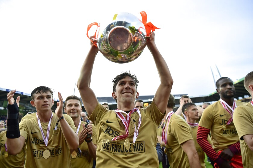 Gustav Wikheim and his FC Midtjylland teammates lifted the Denmark Superliga championship trophy in May 2018 but might play rest of this season at empty arenas with fans in the parking lot watching on video boards.