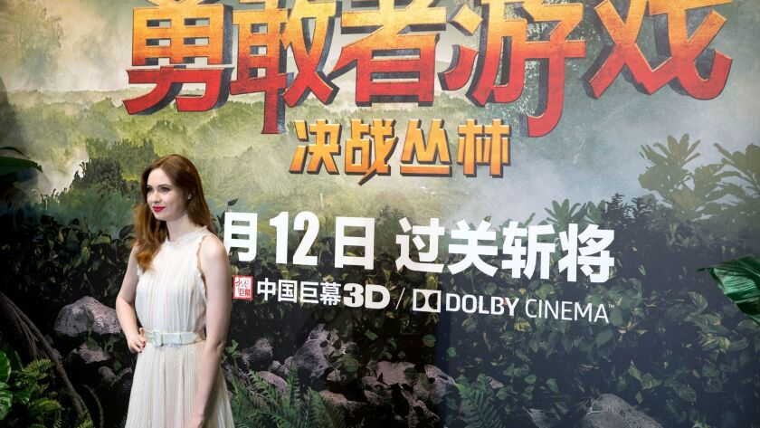 """British actress Karen Gillan poses before a news conference in Beijing for """"Jumanji: Welcome to the Jungle."""" The movie has grossed $66.5 million in China since its debut Jan. 12."""