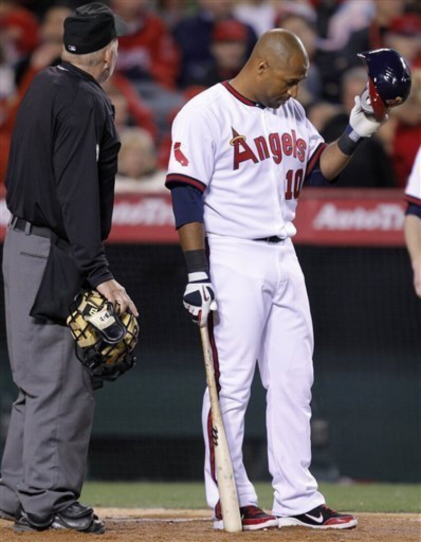 Los Angeles Angels center fielder Vernon Wells reacts after being struck out by Toronto Blue Jays starting pitcher Kyle Drabek in the fifth inning of a baseball game in Anaheim, Calif., Friday, April 8, 2011. (AP Photo/Jae C. Hong)