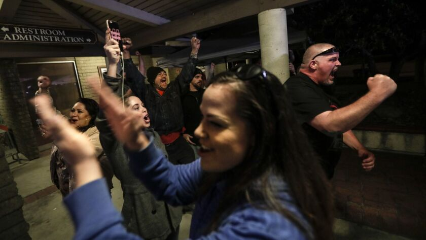 LOS ALAMITOS, CA, MONDAY, MARCH 19, 2018 - Spectators cheer as the Los Alamitos City Council votes t