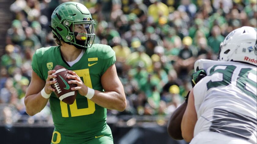 FILE - In this Sept. 8, 2018, file photo, Oregon quarterback Justin Herbert (10) looks for a receive