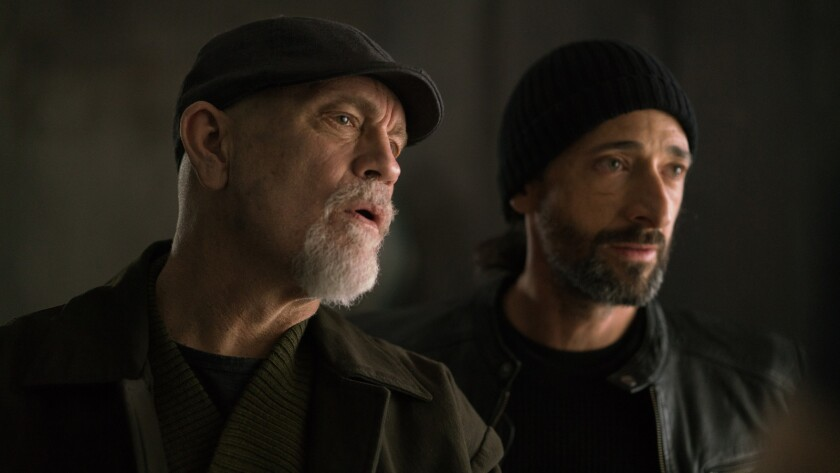 """John Malkovich, left, and Adrien Brody in the movie """"Bullet Head."""""""