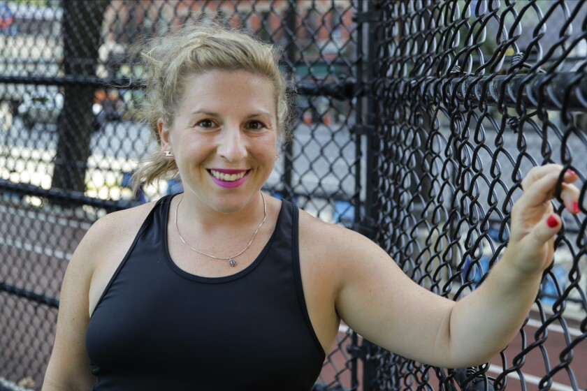 Lauren Wire, a 32-year-old publicist who lives in Manhattan, poses for a portrait before a fitness class Wednesday, July 15, 2020, in New York. Many Americans are changing clothing sizes depending on how they spent their time sheltering at home. Wire gained back 12 of the 50 pounds she lost leading up to the pandemic because she was ordering in a lot from restaurants and partaking in social distance cocktails with friends. She says she bought new shorts and swimwear when she gained the weight but now she's starting to shed pounds again by biking outside. (AP Photo/Frank Franklin II)