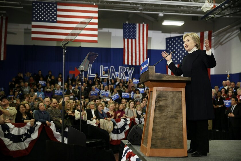 FILE - In this Feb. 9, 2016 file photo, Democratic presidential candidate Hillary Clinton speaks in Hooksett, N.H. Clinton is staking her campaign comeback hopes on her ability to woo black and Latino voters, placing outreach to them at the center of her strategy to retool her 2016 bid.  (AP Photo/