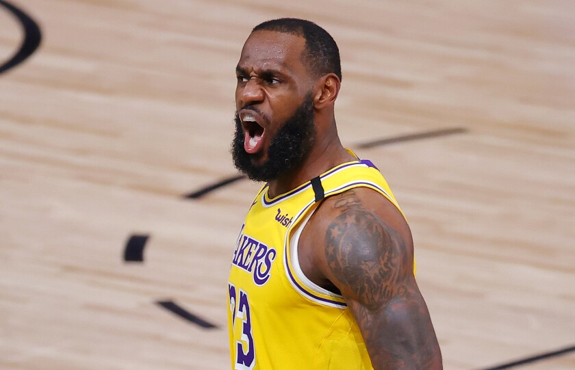 Lakers star LeBron James reacts after a dunk during the third quarter of the Lakers' 111-88 victory in Game 2 on Thursday.