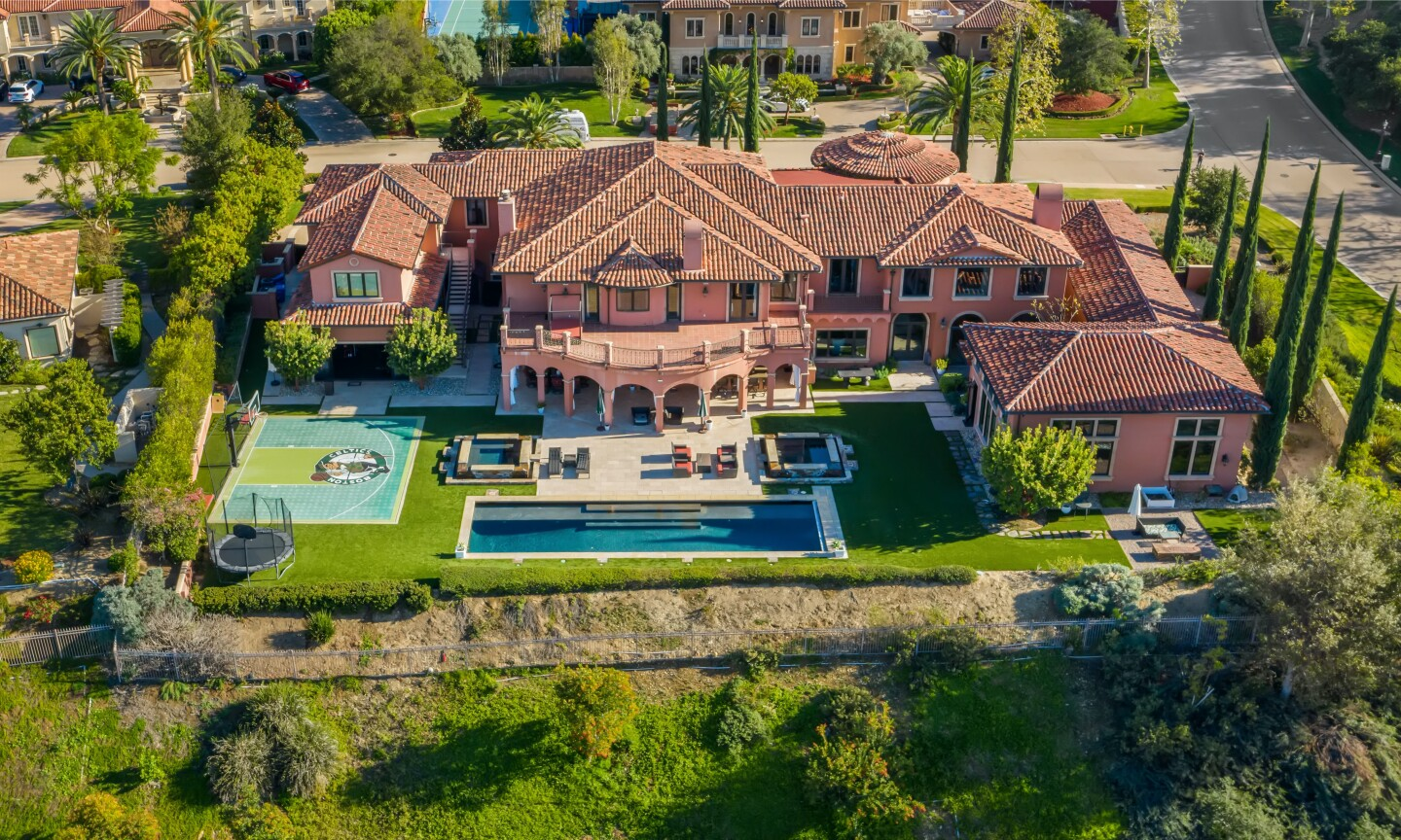 The estate centers on a 12,250-square-foot mansion with six bedrooms, nine bathrooms, a movie theater and bowling alley.