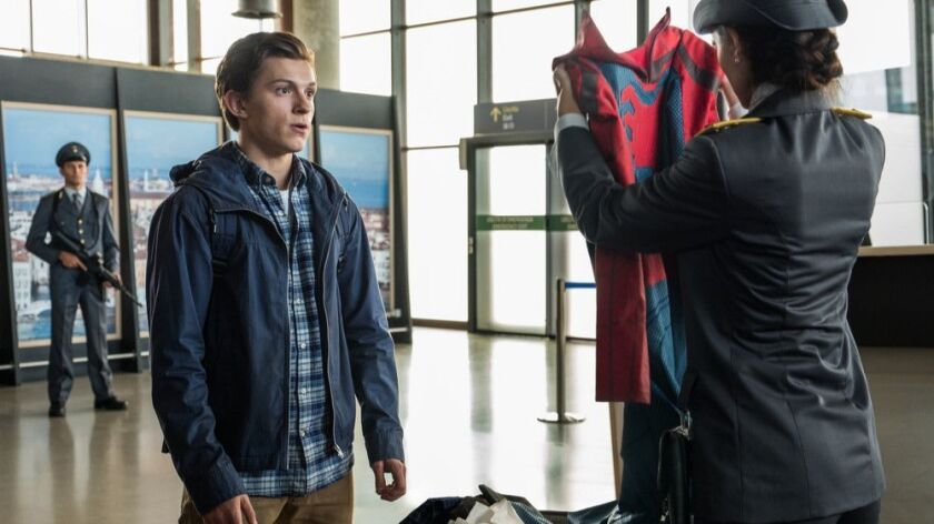 "Peter Parker (Tom Holland) is stopped by an Italian customs officer (Giada Benedetti) in Sony Pictures' ""Spider-Man: Far From Home."" The film brings the first three phases of the Marvel Cinematic Universe to a close and concludes the decade-spanning Infinity Saga."