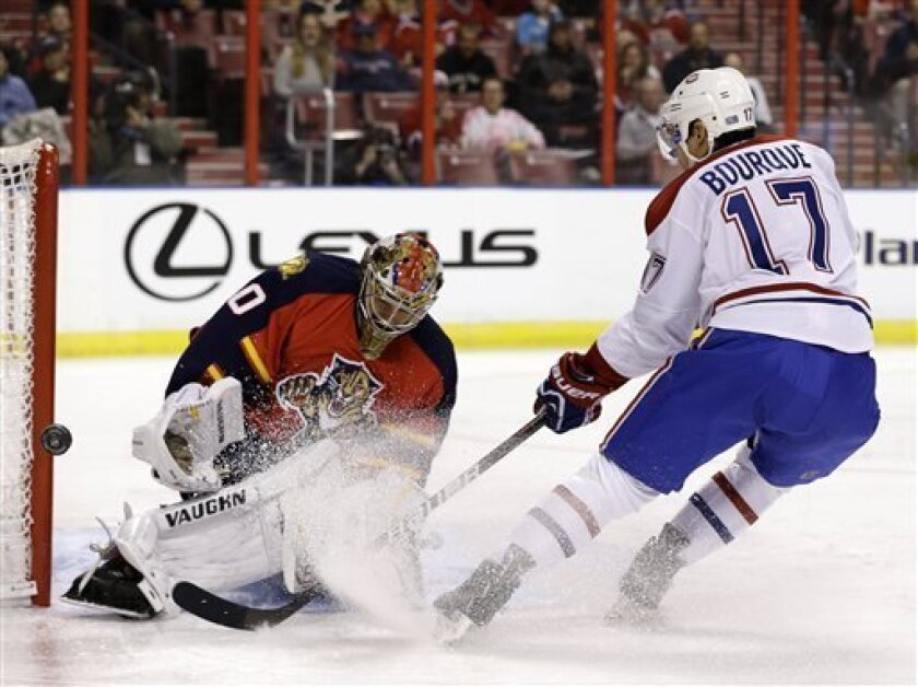 Montreal Canadiens left wing Rene Bourque (17) attempts a shot at Florida Panthers goalie Jose Theodore during the first period of an NHL hockey game, Thursday, Feb. 14, 2013, in Sunrise, Fla. (AP Photo/Wilfredo Lee)