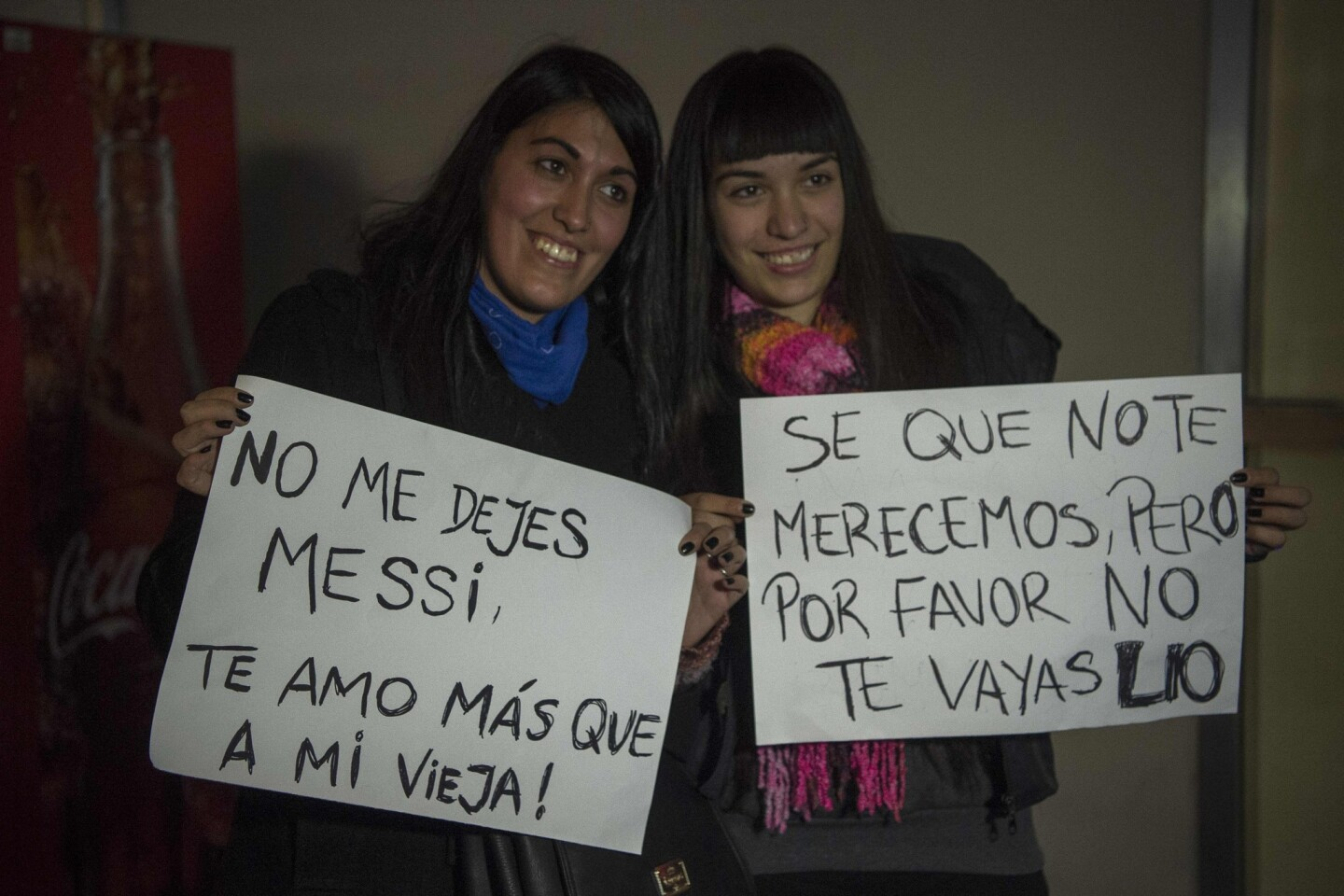 Two young women hold signs asking Lionel Messi no to quit, while waiting for the arrival of Argentina's football team from the Copa America Centenario held in the United States, on June 27, 2016 in Buenos Aires. Argentina lost the final against Chile 4-2 in the penalty shoot-out. Argentines begged Lionel Messi -who tearfully decided to quit the international team after missing a spot-kick in the shootout- not to leave the national team despite its traumatic final. / AFP PHOTO / EITAN ABRAMOVICHEITAN ABRAMOVICH/AFP/Getty Images ** OUTS - ELSENT, FPG, CM - OUTS * NM, PH, VA if sourced by CT, LA or MoD **