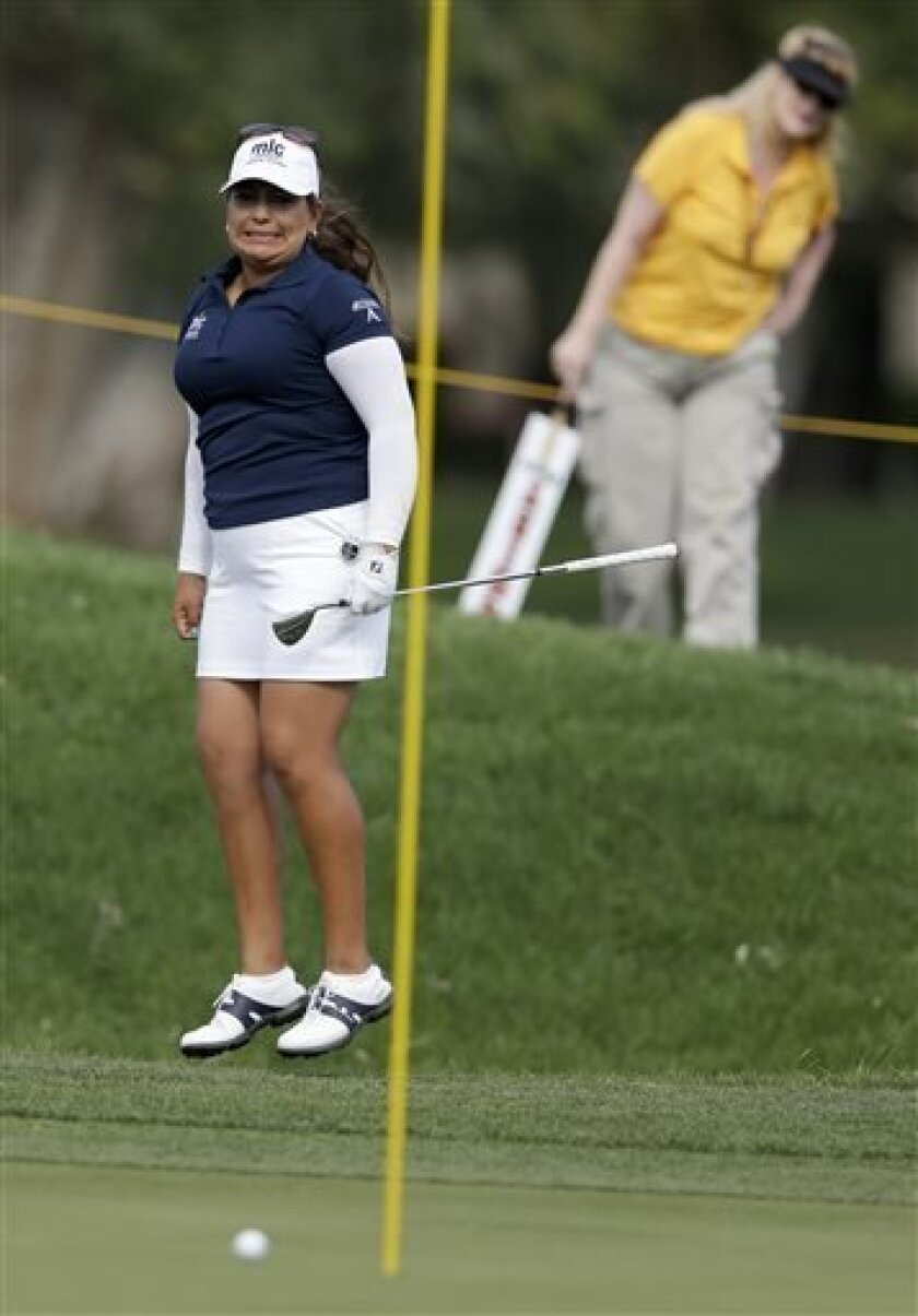 Lizette Salas reacts after almost chipping in for birdie on the 17th hole during the second round of the LPGA Kraft Nabisco Championship golf tournament in Rancho Mirage, Calif. Friday, April 5, 2013. (AP Photo/Chris Carlson)