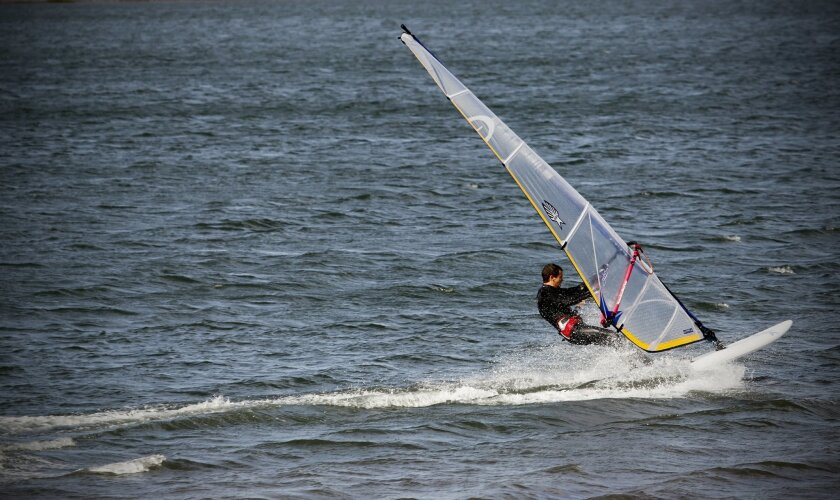 A Windsurfer takes advantage of the strong winds last year on Mission Bay near Fiesta Island.