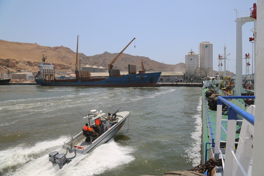An armed Coast Guard boat patrols the port in Mukalla, Yemen, the main source of local revenue for t