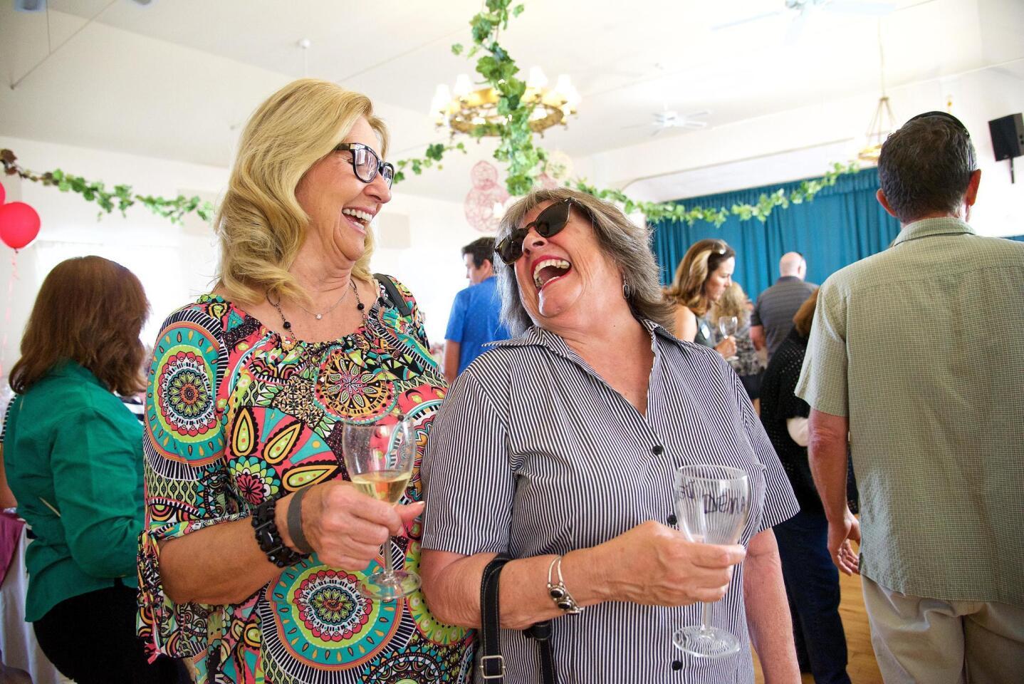 Janice Carrizosa and Denay Wilson share a laugh.