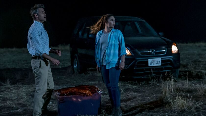"Timothy Olyphant and Drew Barrymore in a scene from ""Santa Clarita Diet."""