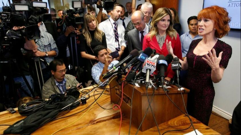 Flanked by attorneys Dmitry Gorin, left, and Lisa Bloom, Kathy Griffin answered questions from the p