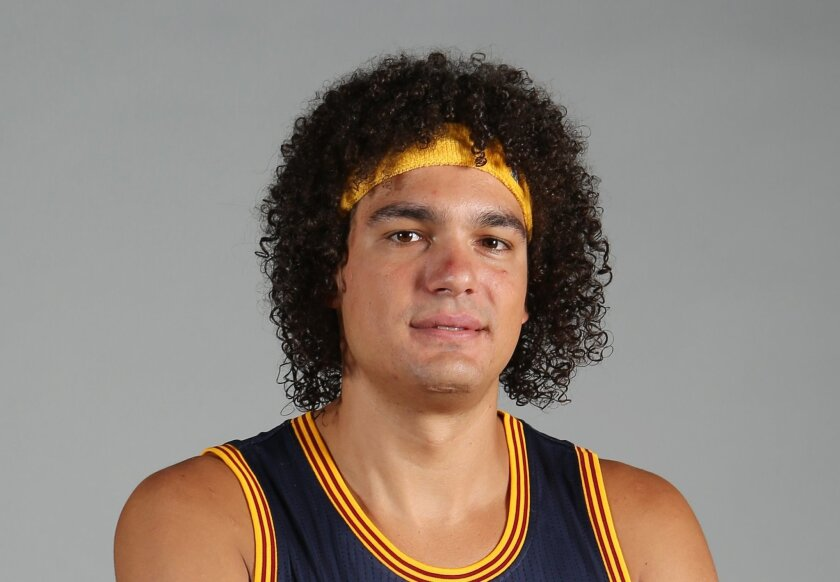 FILe - In this Sept. 28, 2015, file photo, Cleveland Cavaliers' Anderson Varejao poses during the NBA team's media day, in Independence, Ohio. Two people with knowledge of the deal say the Cavaliers have acquired forward Channing Frye from the Orlando Magic in a trade for popular center Anderson Va