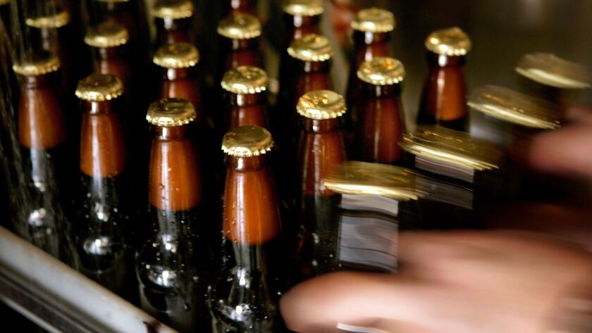 Bottles make their way down the production line at Skyscraper Brewing's former location in El Monte.