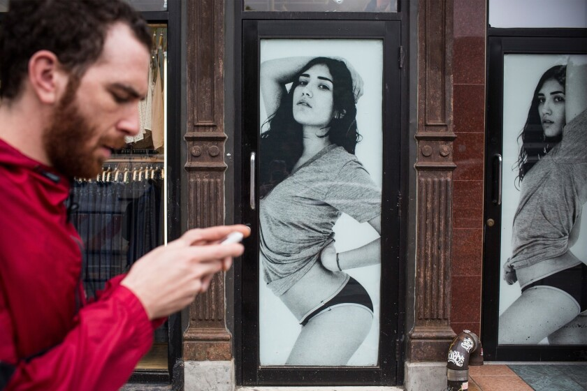 Standard General has proposed a new slate of directors for American Apparel's board. Above, a man walks past an American Apparel store in New York City.