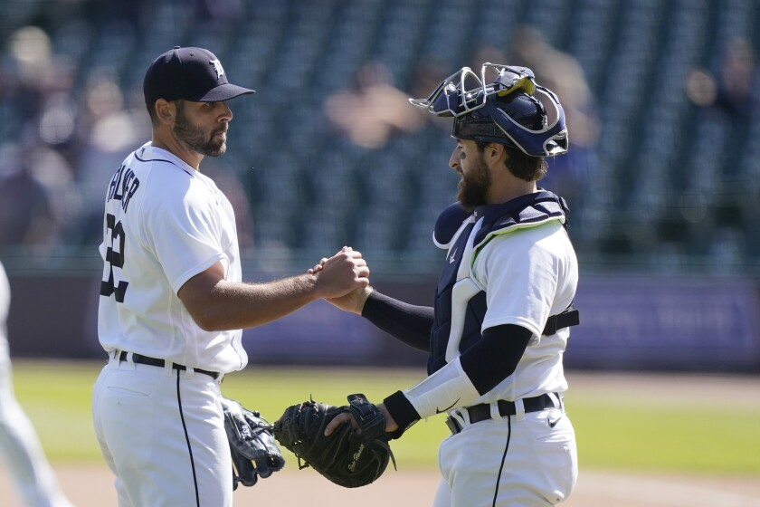 Detroit Tigers relief pitcher Michael Fulmer greets catcher Eric Hasse after saving the ninth inning of a baseball game against the Kansas City Royals, Thursday, May 13, 2021, in Detroit. (AP Photo/Carlos Osorio)