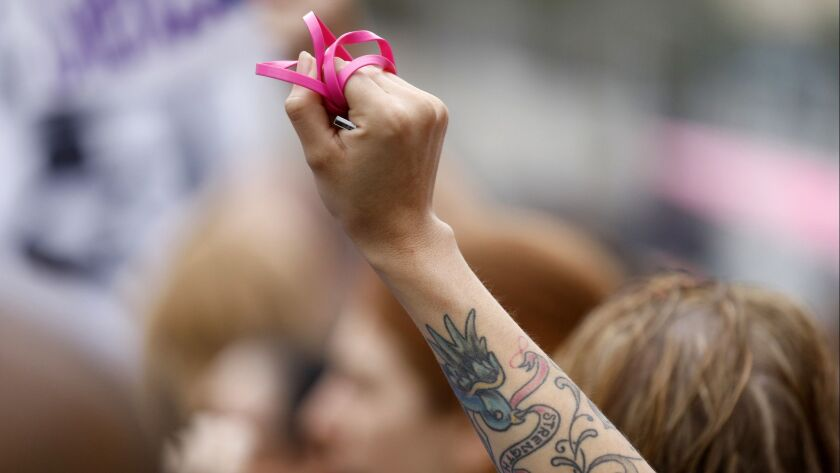 A woman shows support for sexual assault survivors at the #MeToo Survivors' March in Los Angeles on Nov. 12, 2017.