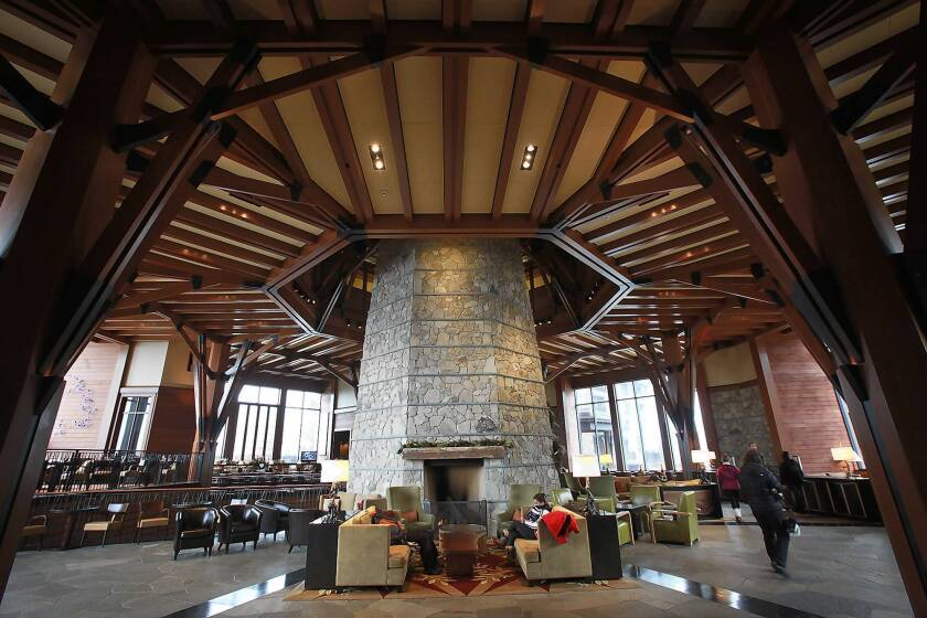 Cozy seating areas surround the stone fireplace column at the Ritz-Carlton hotel at the Northstar resort near Lake Tahoe. Ritz-Carlton invested $300 million to open the six-story, 170 guest room luxury hotel in 2009; it is the only five-diamond, AAA-rated hotel around the lake.