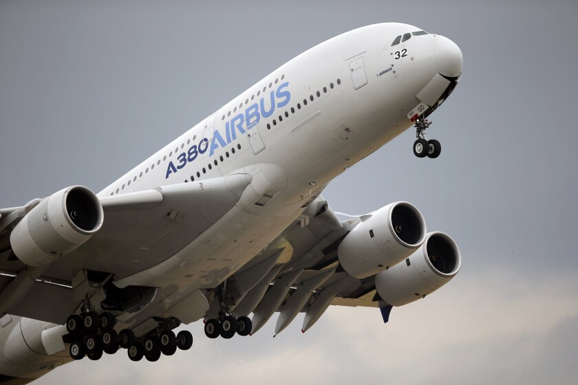 FILE - In this June 18, 2015, file photo, an Airbus A380 takes off for its demonstration flight at the Paris Air Show in Le Bourget airport, north of Paris. A World Trade Organization panel ruled Monday, Dec. 2, 2019, that the European Union has not complied with an order to end illegal subsidies for plane-maker Airbus, which prompted the Trump administration to impose tariffs on nearly $7.5 billion worth of EU goods in October. (AP Photo/Francois Mori, File)