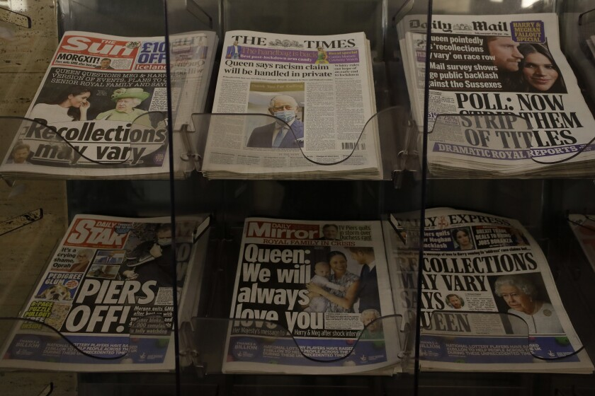 Newspapers on display with front pages featuring images of members of the royal family, outside a shop in London, Wednesday, March 10, 2021. In countries with historic ties to Britain, allegations by Prince Harry and Meghan about racism within the royal family have raised questions about whether those nations want to be closely connected to Britain anymore after the couple's interview with Oprah Winfrey. (AP Photo/Kirsty Wigglesworth)