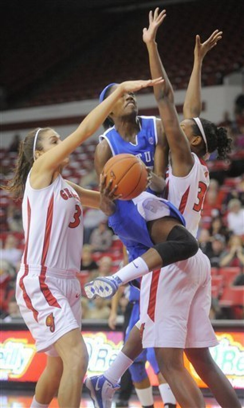 Kentucky's Victoria Dunlap has her shot blocked by Georgia's Anne Marie Armstrong (3) and Angel Robinson (33) during the first half of an NCAA college basketball game in Athens, Ga., on Thursday, Jan. 7, 2010. (AP Photo/Tricia Spaulding)
