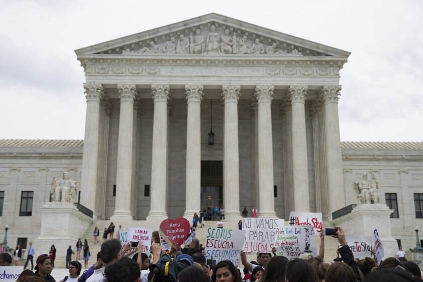 Demonstrators gather outside the Supreme Court in Washington, Thursday, June 23, 2016.  In a major victory for affirmative action, a divided Supreme Court upheld the University of Texas admissions program that takes account of race. The justices voted in favor of the Texas program by a 4-3 vote, an
