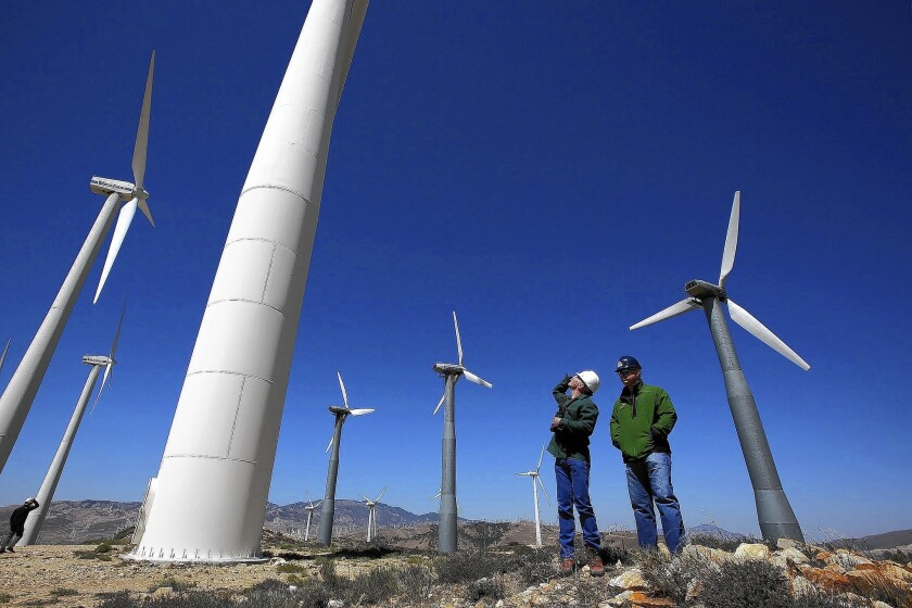 Kevin Martin, left, and Randy Hoyle of Terra-Gen Power inspect wind turbines at Alta East wind energy project in the Tehachapis last month.