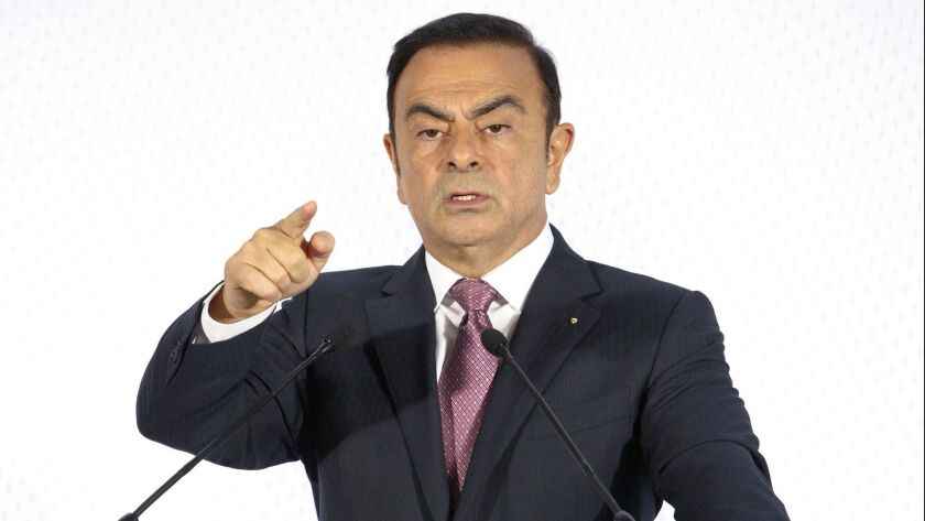 FILE - In this Feb. 12, 2015, file photo, Chairman and CEO of Renault-Nissan Carlos Ghosn addresses
