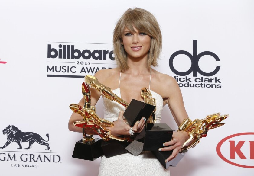 """Taylor Swift poses at the Billboard Music Awards.Her crossover smash """"1989"""" is the top-selling album of 2015 so far."""