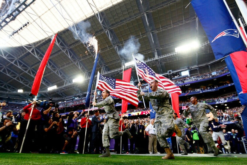Members of the United States military run onto the field prior to Super Bowl XLIX between the Seattle Seahawks and the New England Patriots.