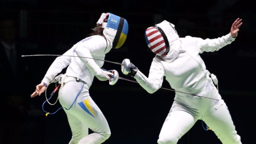 Courtney Hurley of the United States and Yana Shemyakina of Ukraine, left, compete in the women's individual epee event at the 2016 Summer Olympics.