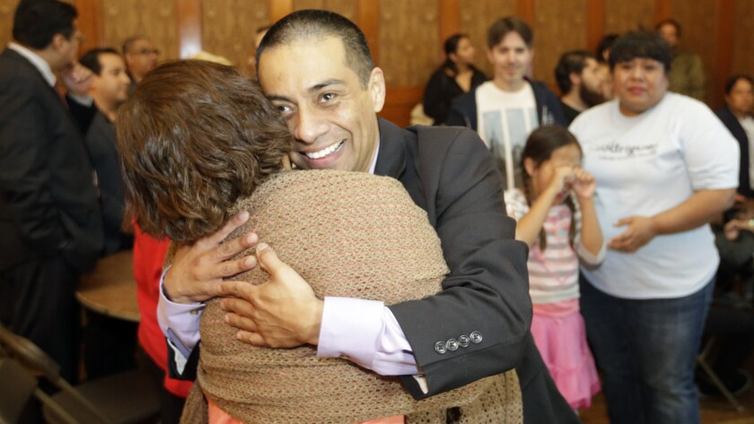 With victory in sight, LAUSD District 5 candidate Ref Rodriguez hugs a supporter at his election headquarters in Highland Park on May 19.