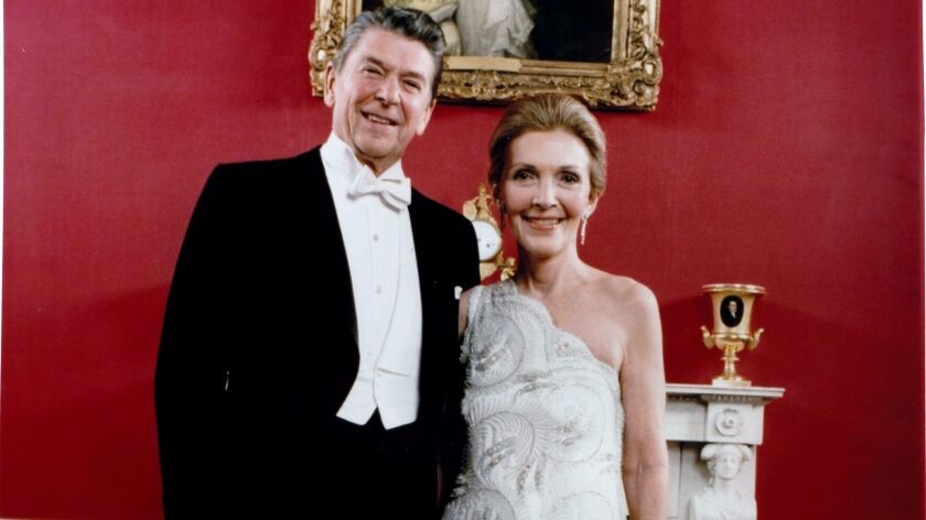 In a photo from the 1980s, former first lady Nancy Reagan, seen with President Ronald Reagan, wore a Galanos dress.