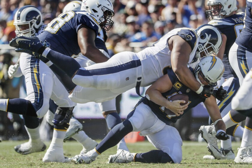 Chargers quarterback Philip Rivers is sacked by Rams defensive lineman Ndamukong Suh during a third quarter drive on Sept. 23