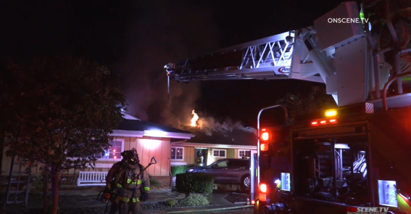 Flames spread from the fireplace to the attic of this Del Cerro home early Sunday morning, displacing a family.