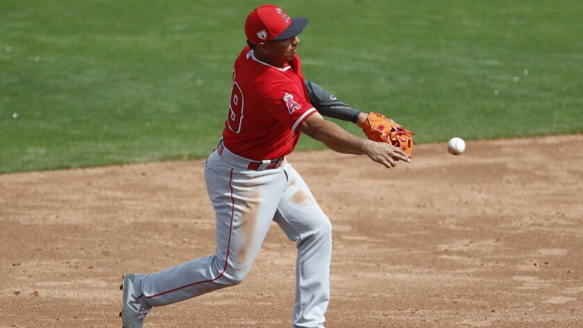 The Angels' Wilfredo Tovar makes a defensive play against the Kansas City Royals during the third inning of a spring training baseball game.