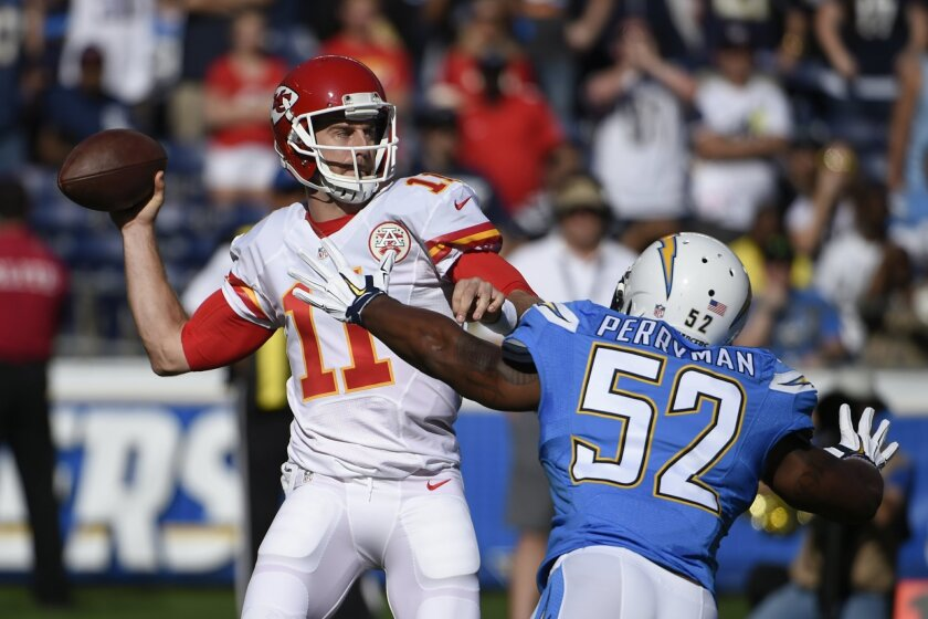 Kansas City Chiefs quarterback Alex Smith throws a pass as San Diego Chargers inside linebacker Denzel Perryman (52) defends during the first half of an NFL football game Sunday, Nov. 22, 2015, in San Diego. (AP Photo/Denis Poroy)